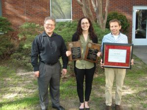 Left to right: Graduate Director Jason DeCaro, Jessica Kowalski holding the DeJarnette Scholarship and the Richard A. Krause Award, and Paul Eubanks holding the A&S Outstanding Research by a Doctoral Student Award at Graduate Honor's Day 4-4-16.