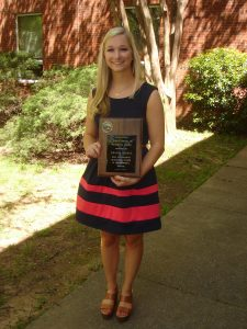 Amanda Oldani holding C. Earl Smith Award at Undergraduate Honor's Day 4-8-16.