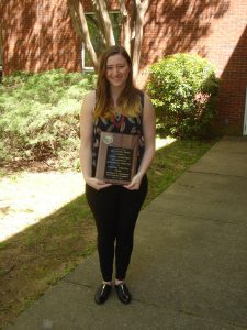 Ashley Daugherty holding Hughes Prize plaque at Undergraduate Honor's Day 4-8-16.