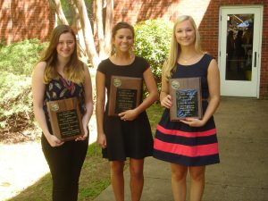 Left to right: Ashley Daugherty holding Hughes Prize plaque and Taylor Lawhon and Amanda Oldani holding Smith Award plaques at Undergraduate Honor's Day 4-8-16.