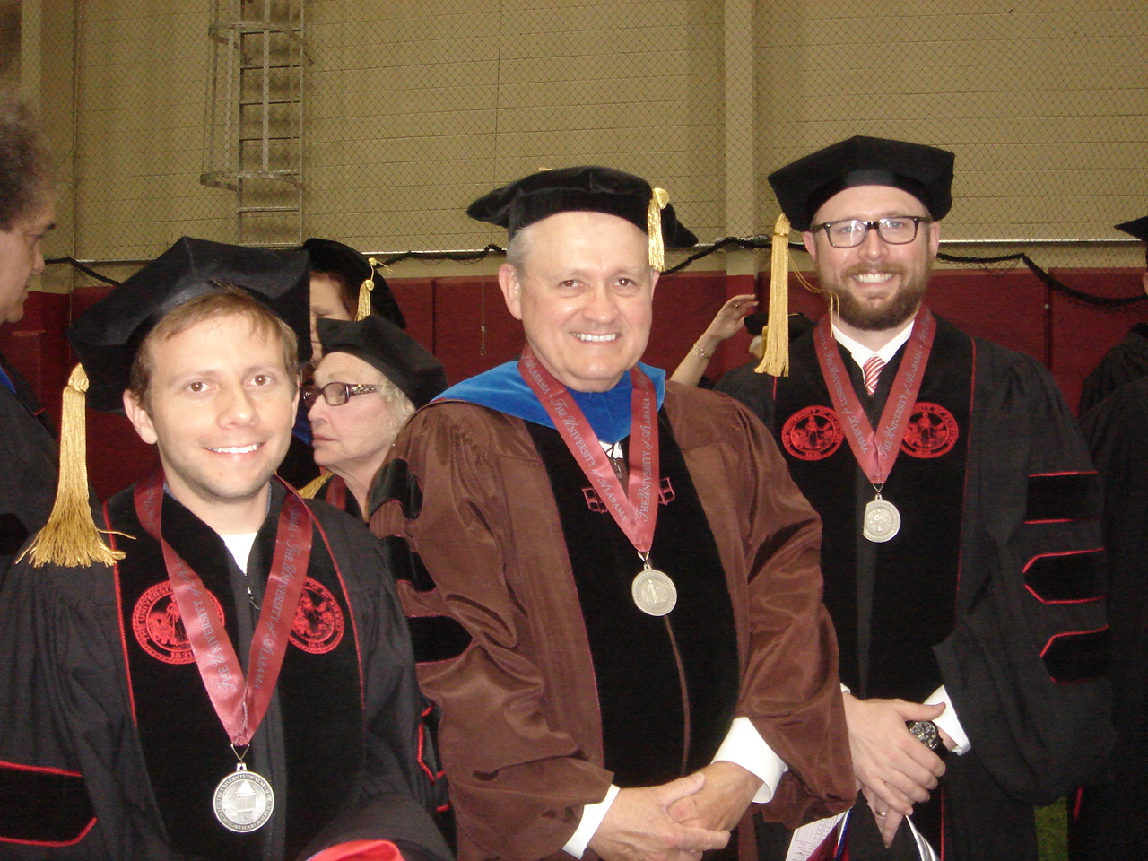 three men in academic regalia